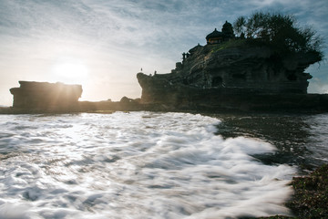 Wall Mural - Tanah Lot temple in Bali, Indonesia at sunset. National landmark, famous touristic place