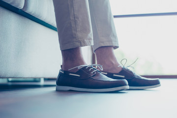 Portrait of legs with modern, fashionable men's shoes with shoelaces