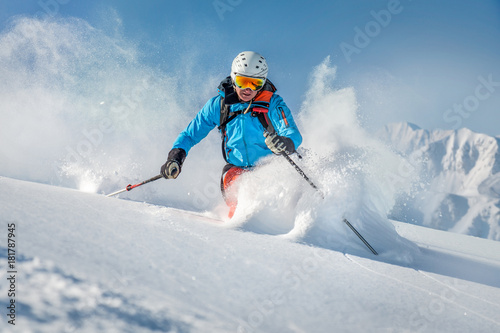 Wall mural Male freeride skier in the mountains off-piste