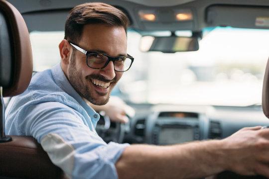Portrait of a businessman driving car