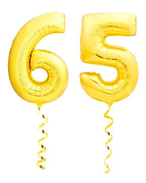 Golden number sixty five 65 made of inflatable balloon with ribbon on white