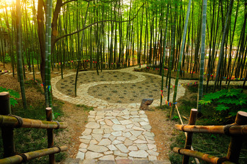 A taoist Ying and yang symbol walking path within a bamboo forest in the Wuxi china three kingdoms attraction in Jiangsu province.