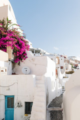 Famous white buildings on of Oia town street in Santorini, Greece
