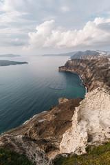 Coast with volcanic sand in Santorini, Greece