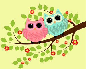 Pair of bright cute cartoon owls sitting on the flowering branches of fantastic trees