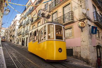 Colorful life in Portugal. Yellow tram on the city streets.