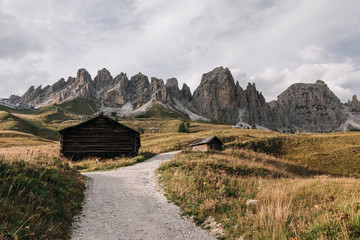 Rural view of houses in mountain valley (Val Gardena) in Dolomites, Italy