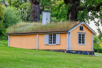 Traditional Old Swedish house with a grass roof