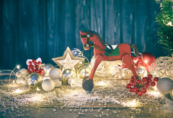 Christmas card with firtree balls and red wooden horse white
