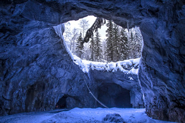 Cave with ice. Karelia in the winter. Settlement Ruskeala in Russia.