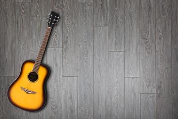 Chitarra su sfondo legno
