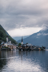Scenic view of famous Hallstatt lakeside town reflecting in Hallstattersee lake in the Austrian Alps, Austria