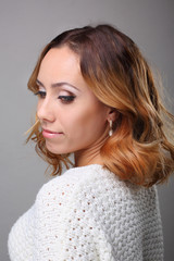 portrait of young woman with curly hair and wedding makeup