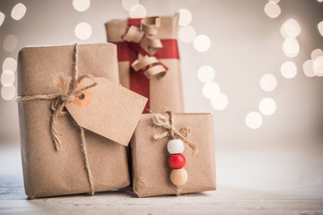 Handcraft gift boxes with tag on bokeh lights background