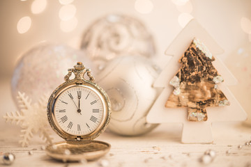 Golden watch and shinning christmas balls as new year background