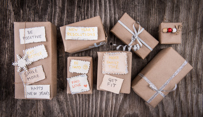 Handcraft presents on wooden background, christmas and new year