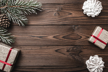Wood background. Fir tree, decorative cone. Sweets. Message space for Christmas and New Year. Gift for holidays. Xmas and Happy New Year composition. Flat lay, top view