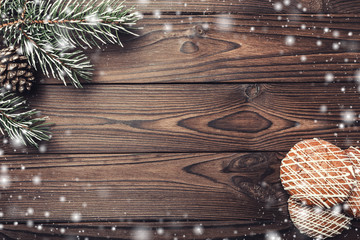 Brown wood background. Fir tree, decorative cone. Message space for Santa, Christmas and New Year. Snowflakes. Cookies. Xmas and Happy New Year composition. Flat lay, top view