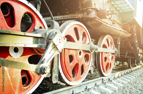 Train drive mechanism and red wheels of an old soviet steam