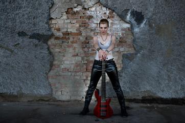A rock musician girl with a guitar