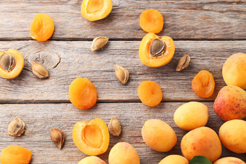 Sweet apricots on grey wooden table