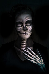 Halloween concept illustration. Makeup Girls image of a skeleton on a black background. Illustration in soft oil painting style.