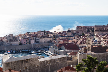 Smoking roof caused by fire in Dubrovnik old town in front of the sea, Croatia