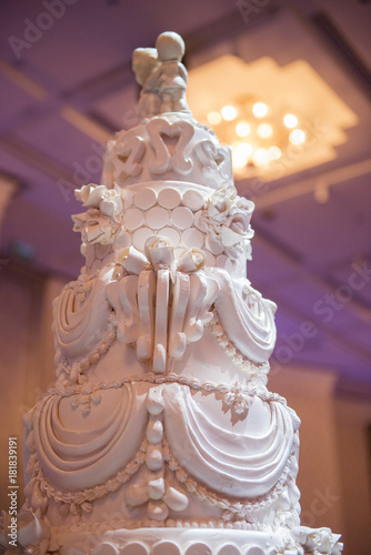 White Wedding Cake With Red Flower Decorate Stock Photo And Royalty