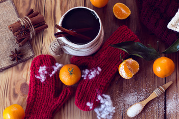warm winter with mittens, tea and tangerines