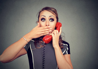 Shocked woman receiving bad news on the phone