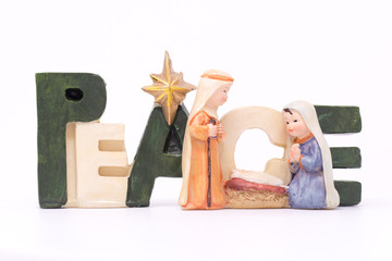 Wooden sign withing peace to one and all during the festive season