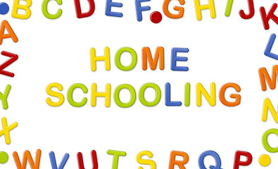 Educational Systems made out of fridge magnet letters isolated on white background: Home Schooling