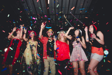Blurred People in Party - Group of Friends Enjoy Throwing Confetti and Dancing in Nightclub
