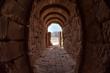 Inside a building excavated into a stone in the ancient city of Petra, Jordan