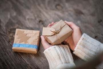 Female hands and Christmas or New Year presents