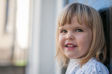 Portrait of little caucasian girl smiling and space for text