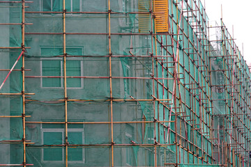 Construction scaffolding outside urban building at construction site