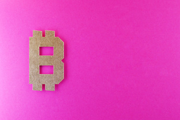 bitcoin currency symbol on pink background