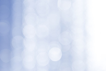 Abstract bokeh over blue blurred background