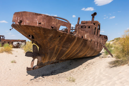 Rusted abandoned vessel in the ship cemetery of Aral Sea, Muynak, Uzbekistan