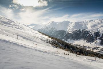 Alpine Ski Resort And Ski Slopes in Winter Season