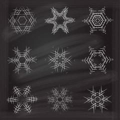 Christmas snowflake set on a chalkboard background.