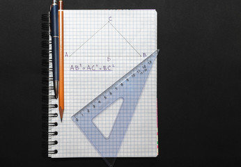 Page with formulas and the Pythagorean theorem with pen, pencil and ruler