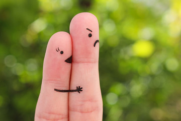 Finger art of couple. Woman kisses man, she don't like him. Concept is not shared love.