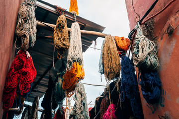 colorful wool hanging at dyers souks, marrakech
