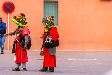 unidentified moroccans wearing traditional costume