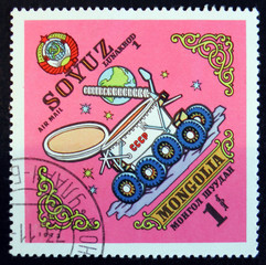 MOSCOW, RUSSIA - APRIL 2, 2017: A post stamp printed in Mongolia shows Lunakhod Soyuz, circa 1973