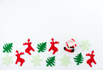 Christmas composition. Christmas tree, dear, Santa Claus on white background. Flat lay, top view