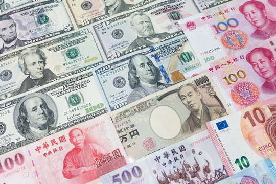 World's various currencies from several different countries. Closeup assorted American dollar bills and Asian currencies such as Chinese yuan, Taiwan dollar, Japanese yen and Euro money.