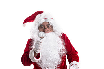 Portrait of santa looked with curiosity through a magnifying glass on camera isolated on white background.